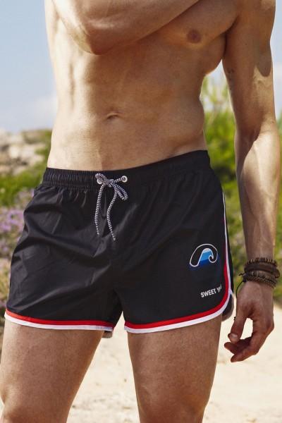 Boxer da mare da uomo in tinta unita con bordino inferiore in contrasto e stampa sulla gamba Sweet Years.